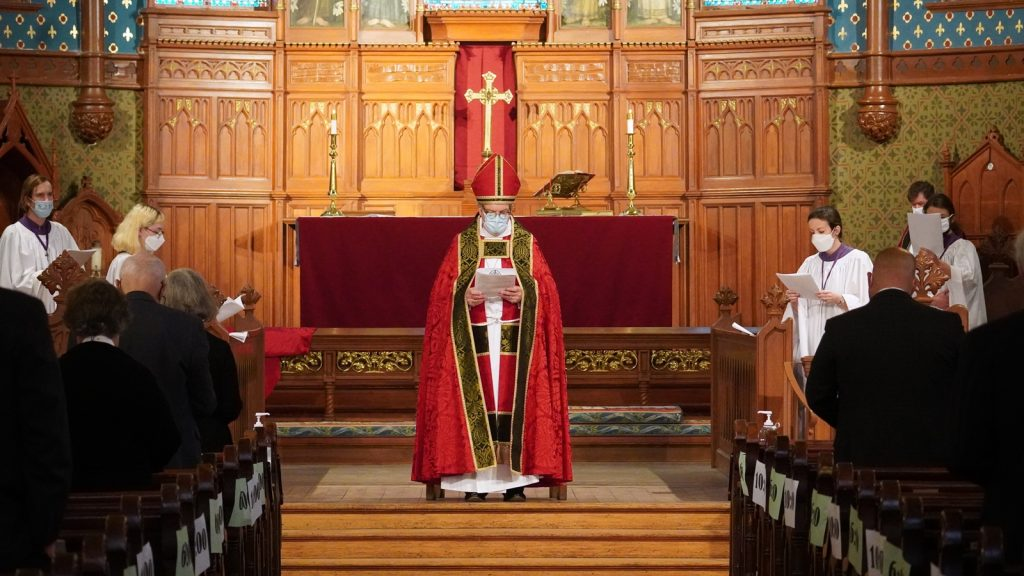 Bishop standing at front of church
