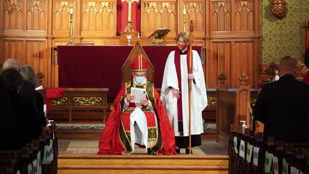 Bishop seated at front of church